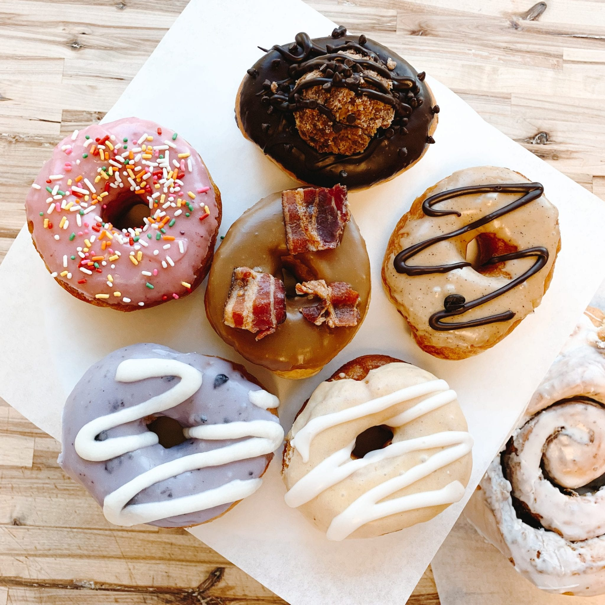 Group of six different donut flavors